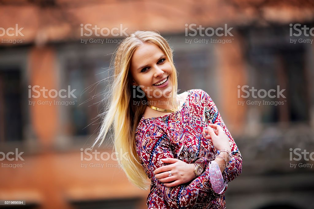 Young fashion blonde girl happy smiles, posing for the camera royalty-free stock photo
