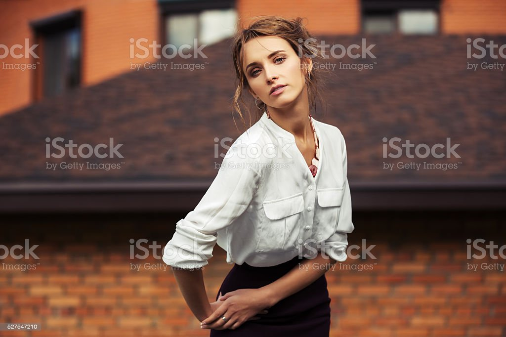 Young fashion business woman on the city street stock photo