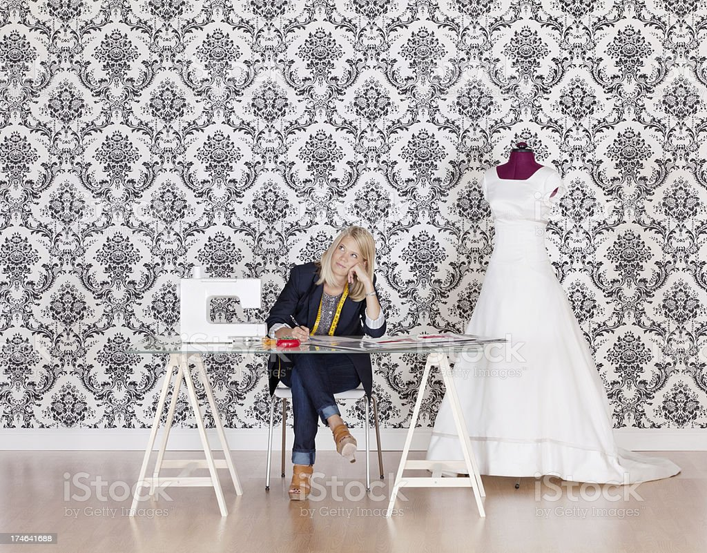 Young fashion designer lost in thoughts royalty-free stock photo