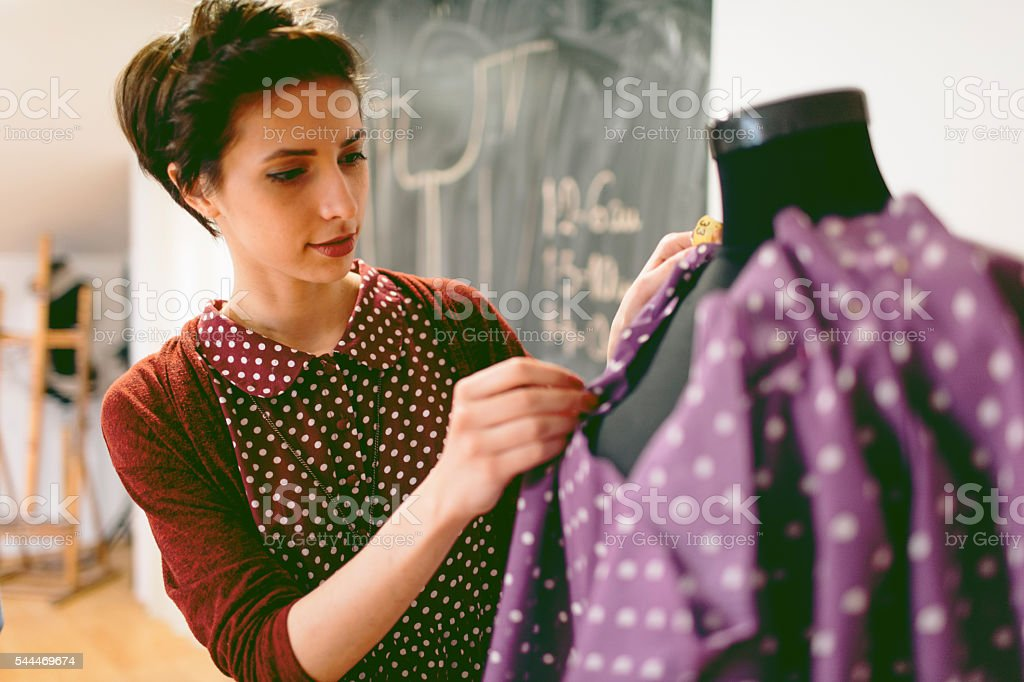 Young Fashion Designer Working In Her Workshop stock photo