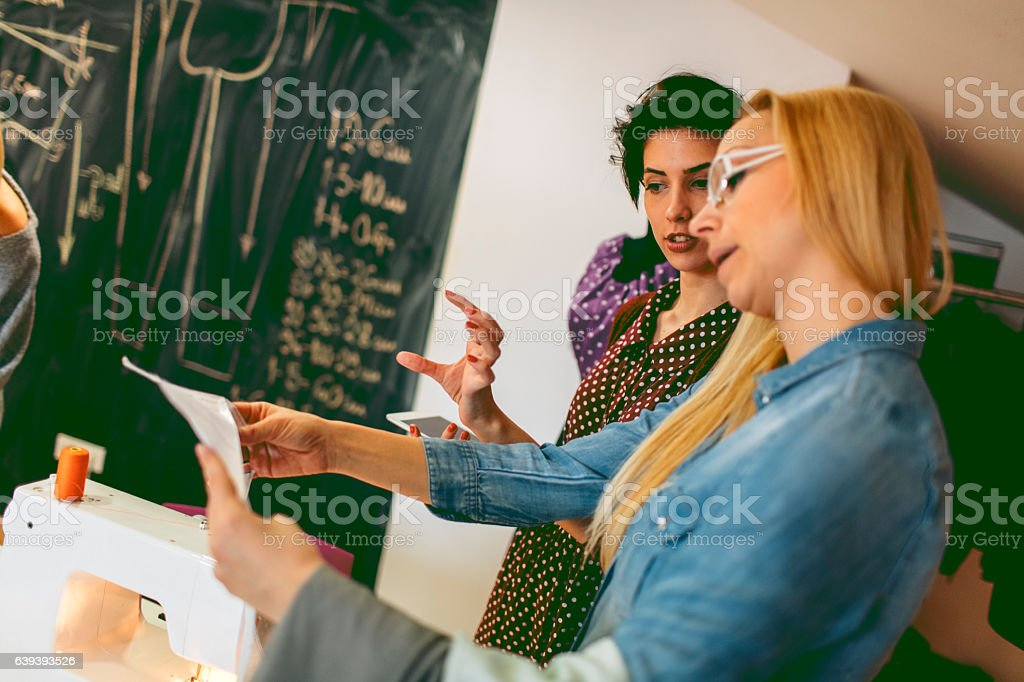 Young fashion designers working in their workshop stock photo