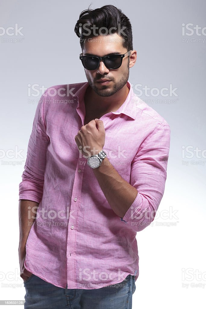 young fashion man with hand on shirt royalty-free stock photo