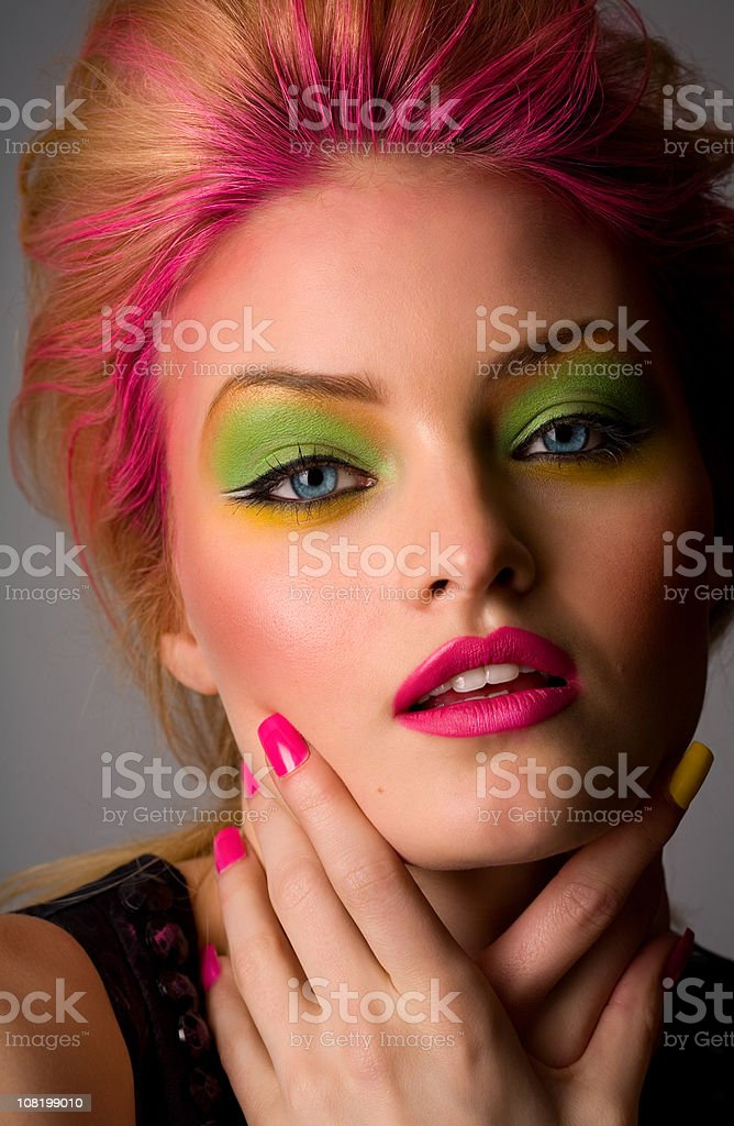 Young Fashion Model WEaring Neon Make-up royalty-free stock photo