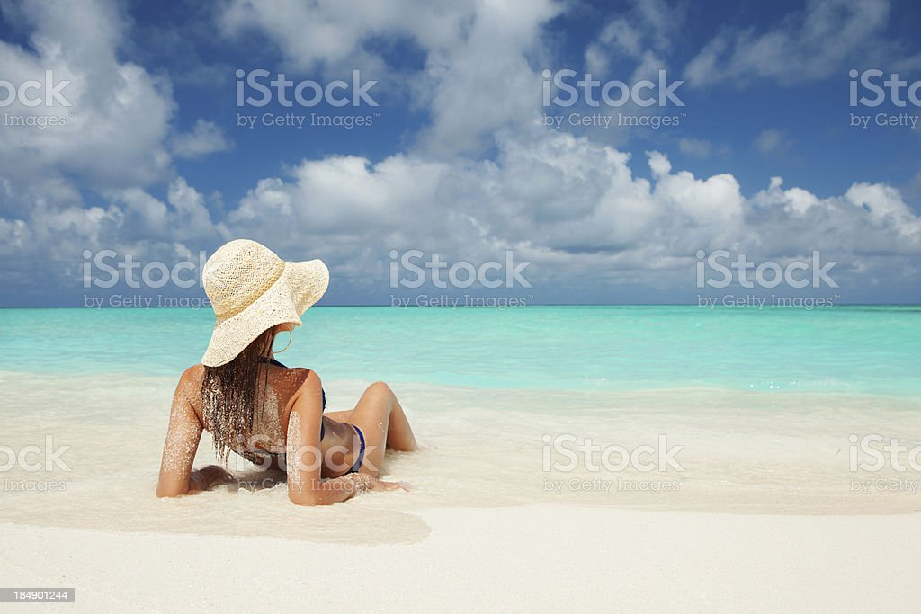 Young fashion woman relax on the beach stock photo
