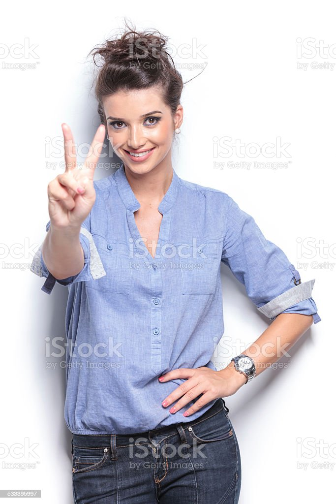 young fashion womanhowing the victory sign stock photo