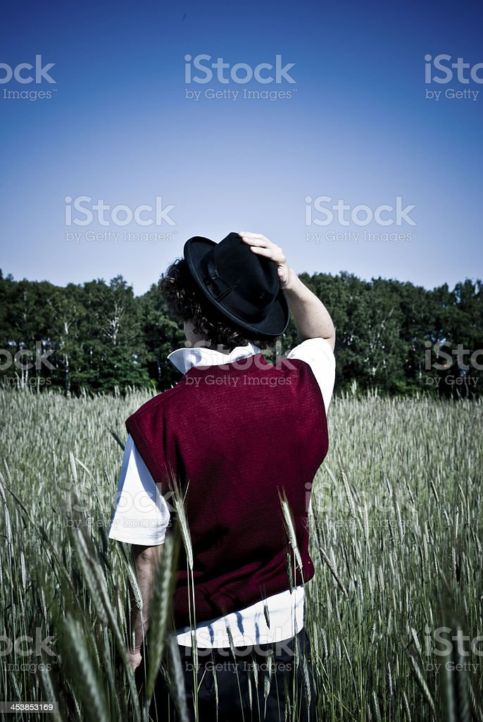 Young fashionable man among corn field royalty-free stock photo