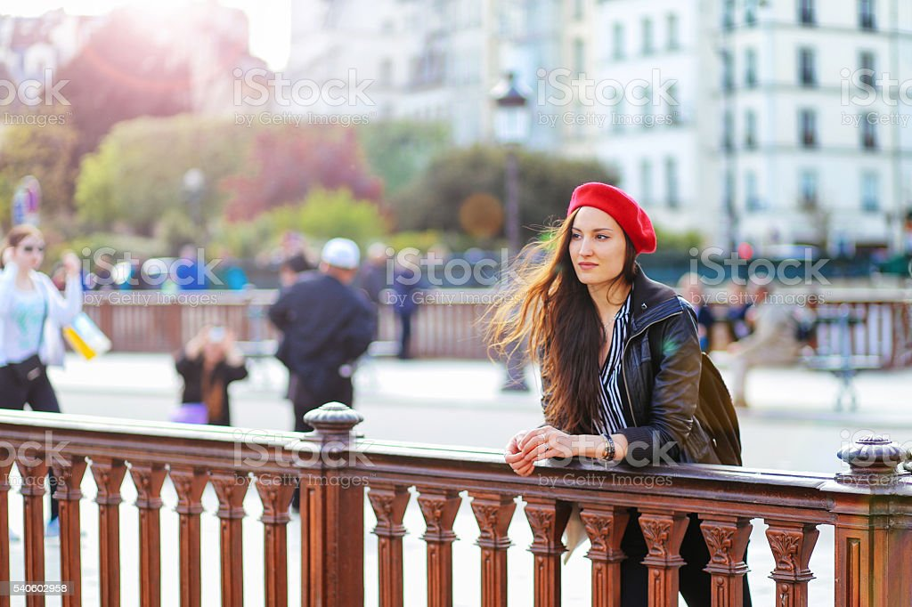 Young fashionable Parisian woman relaxing by the Seine stock photo