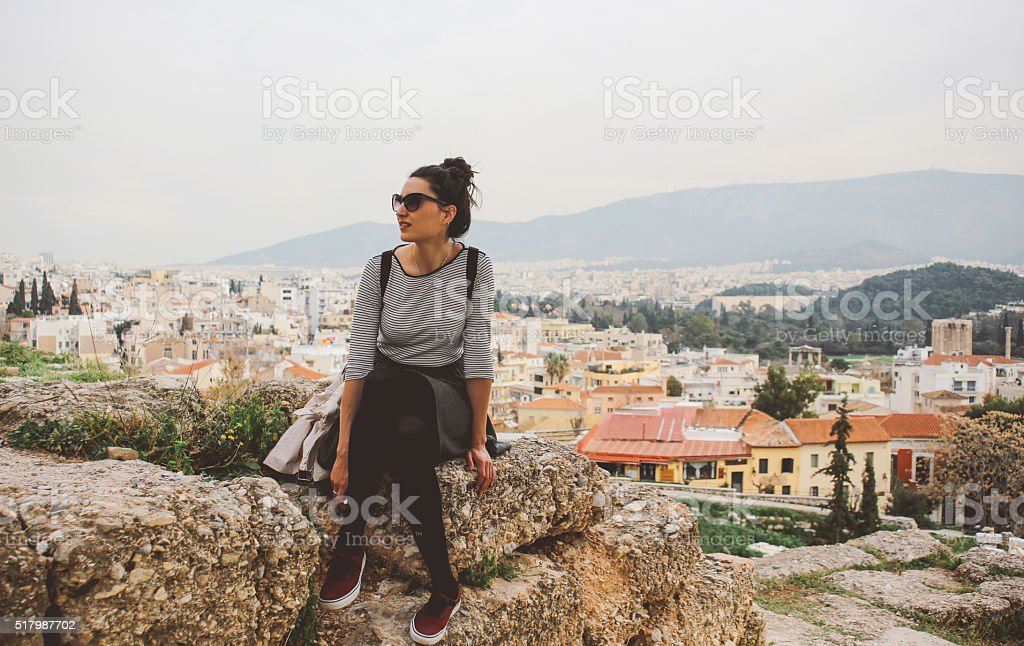 Young fashionable tourist woman relaxing and sightseeing in Athens, Greece stock photo
