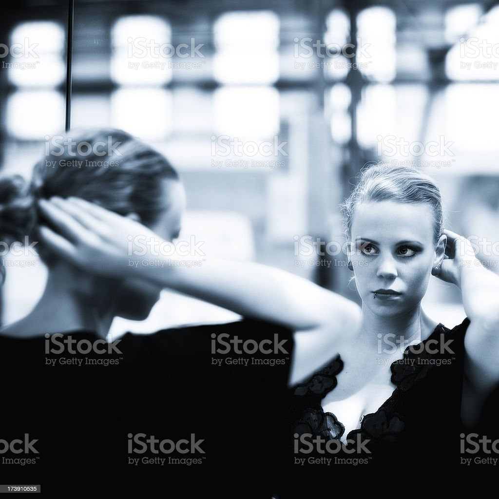young fashionable woman checking her hairs royalty-free stock photo