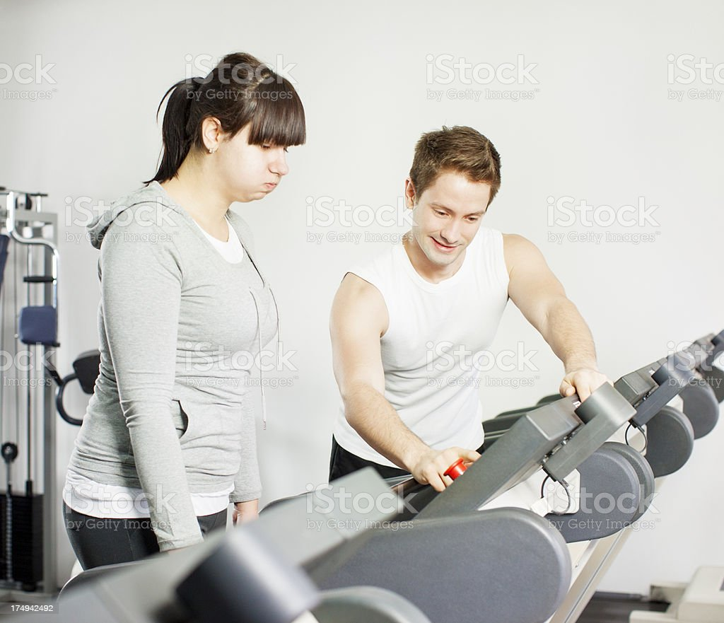 Young Fat Woman Exercise in a gym royalty-free stock photo