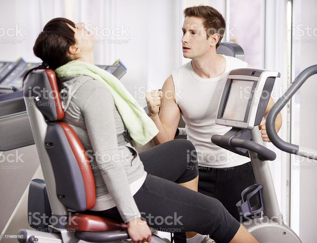 Young Fat Woman Exercise in a gym. royalty-free stock photo