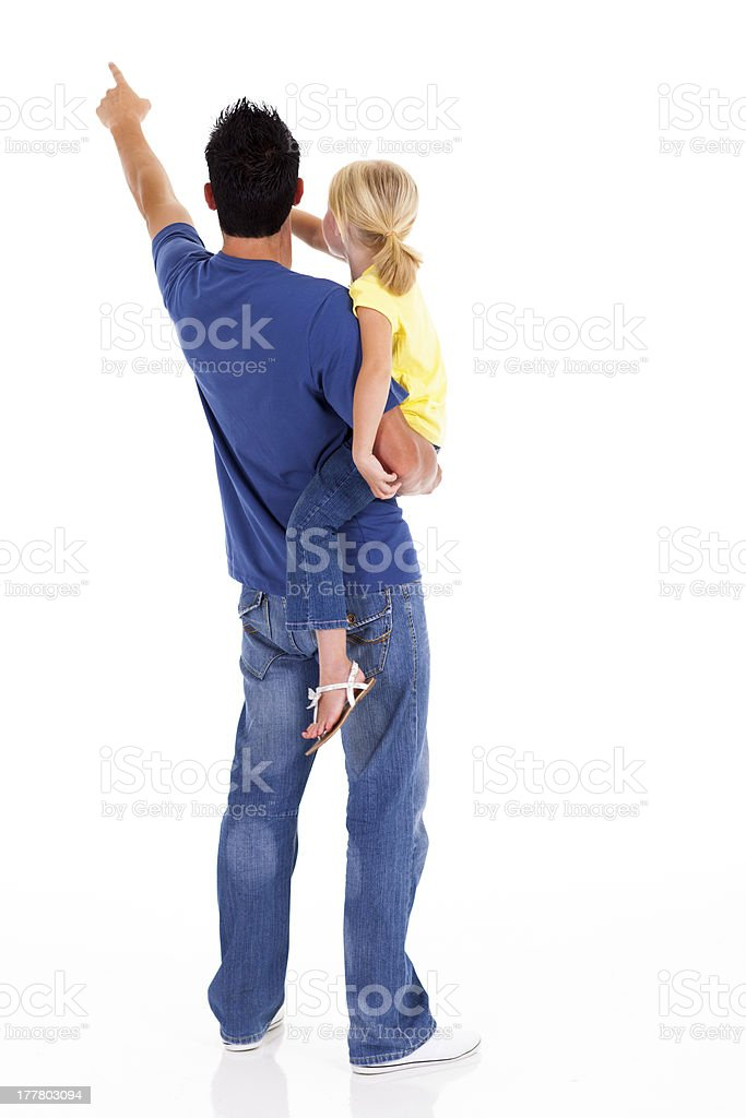 young father and daughter pointing stock photo