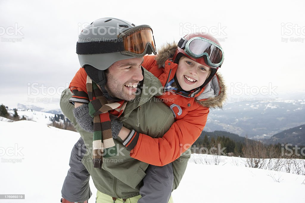 Young Father And Son On Winter Vacation stock photo