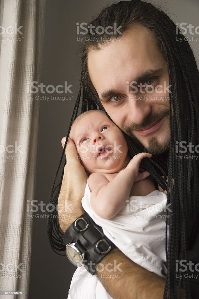 young father embraces the baby royalty-free stock photo