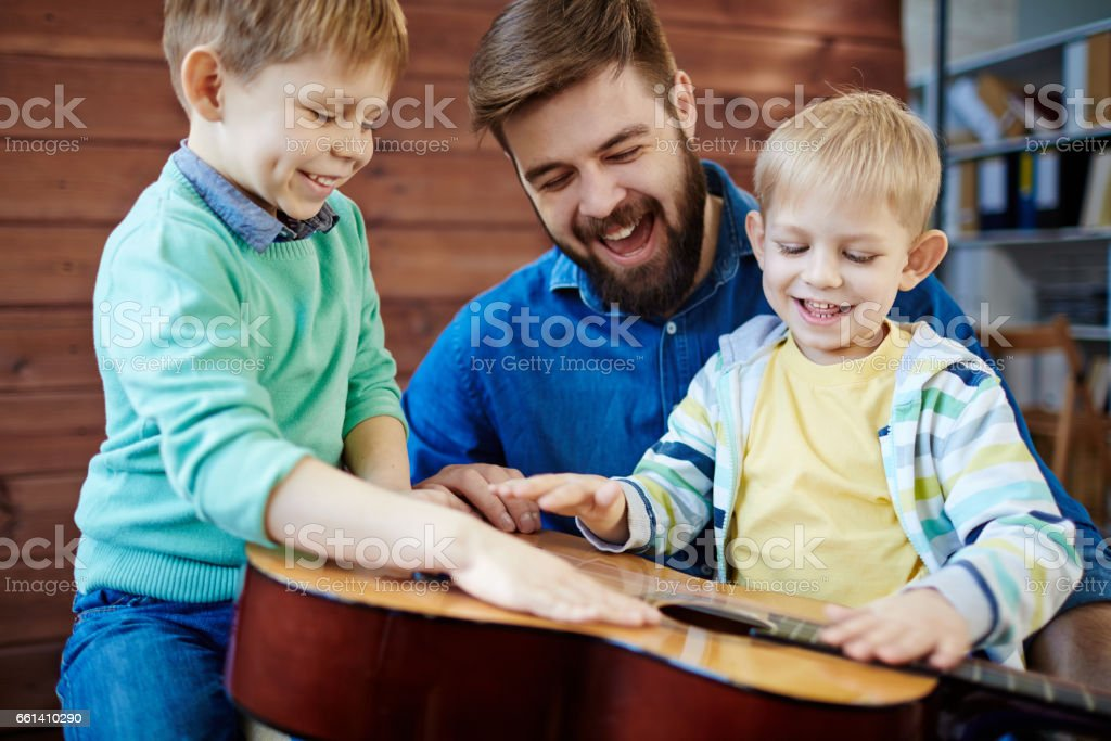 Young father having fun with kids stock photo