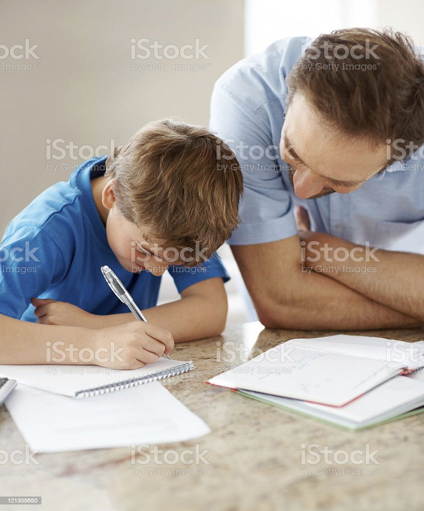 Young father helping his son with homework royalty-free stock photo
