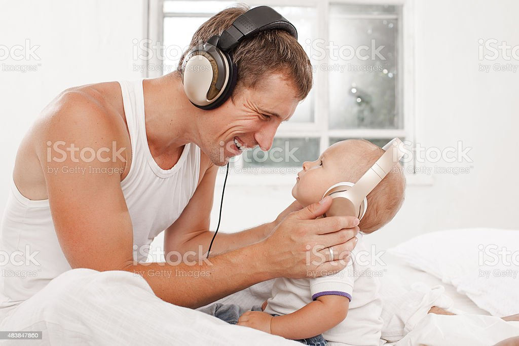 young father with his nine months old som on the stock photo