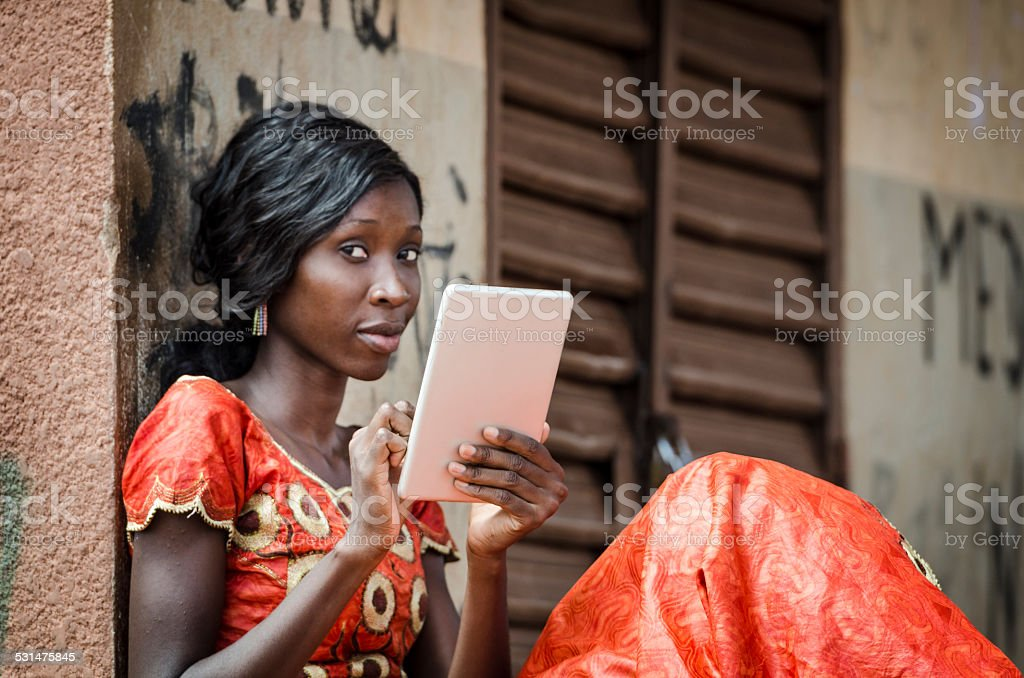 Young Female African Student Posing With Her Tablet in College stock photo