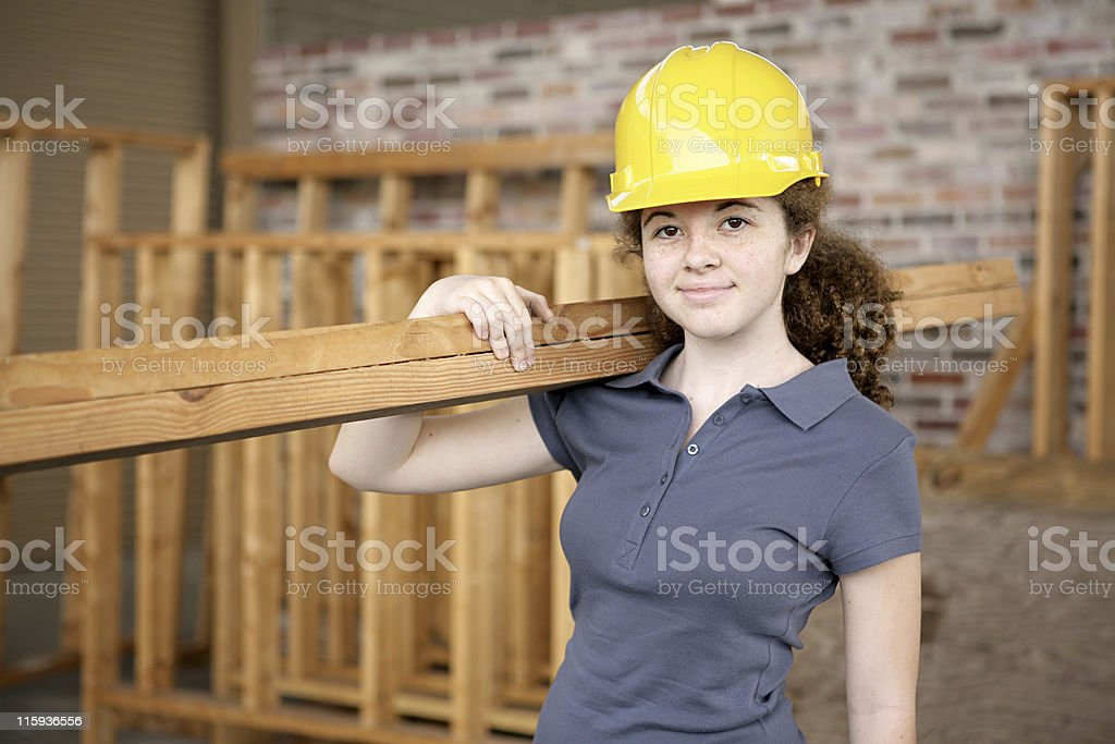 Young, female apprentice in a construction site royalty-free stock photo