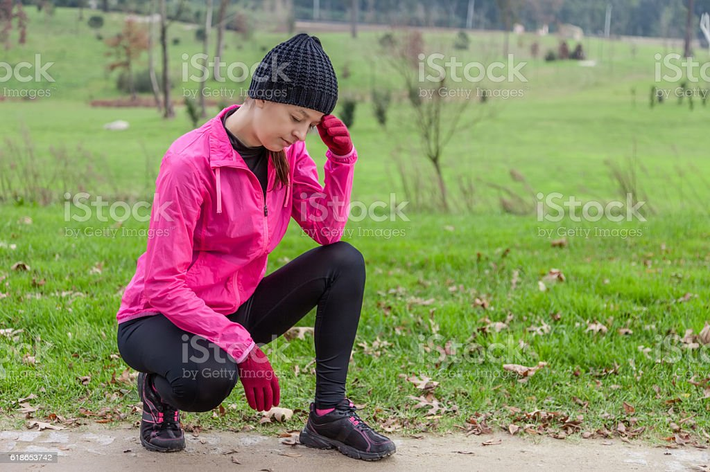 Young female athlete feeling lightheaded or with headache stock photo
