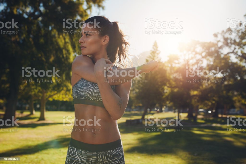 Young female athlete stretching before fitness training stock photo
