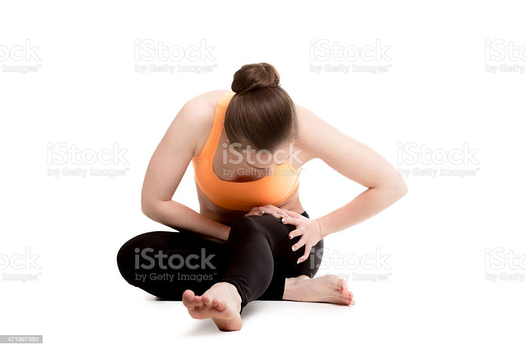 Young female athlete touching injured thigh stock photo