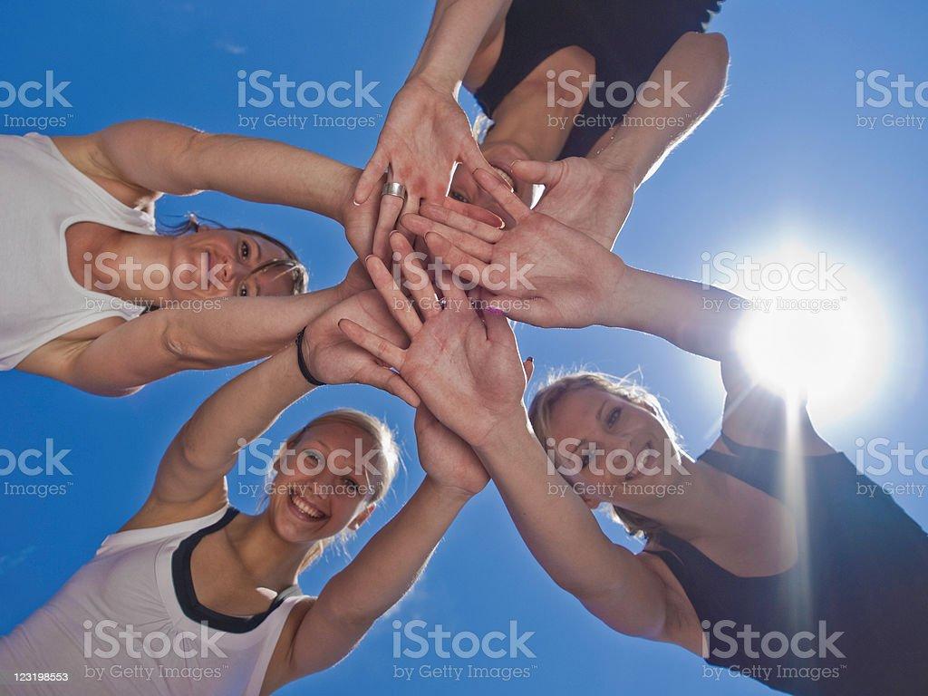 Young female athletes posing on stadium royalty-free stock photo