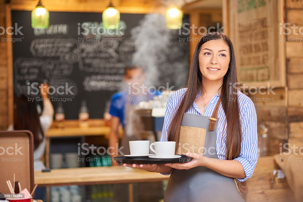 Young female barista stock photo