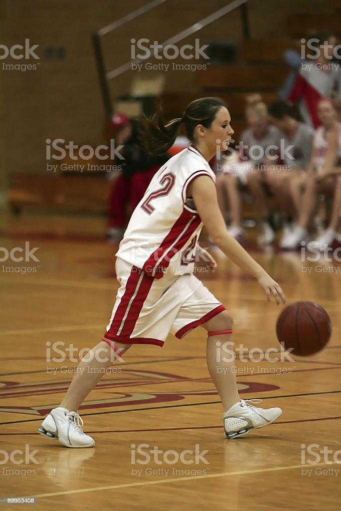 Young Female Basketball Player Dribble on Guardline stock photo