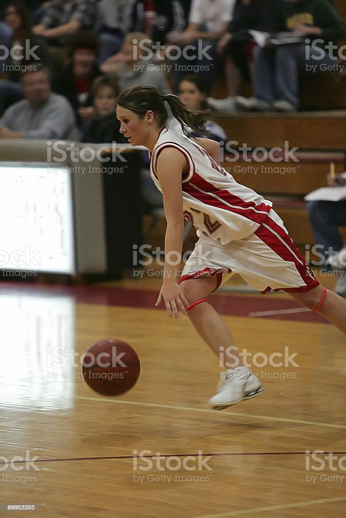 Young Female Basketball Player Sprints on Breakaway Dribble stock photo