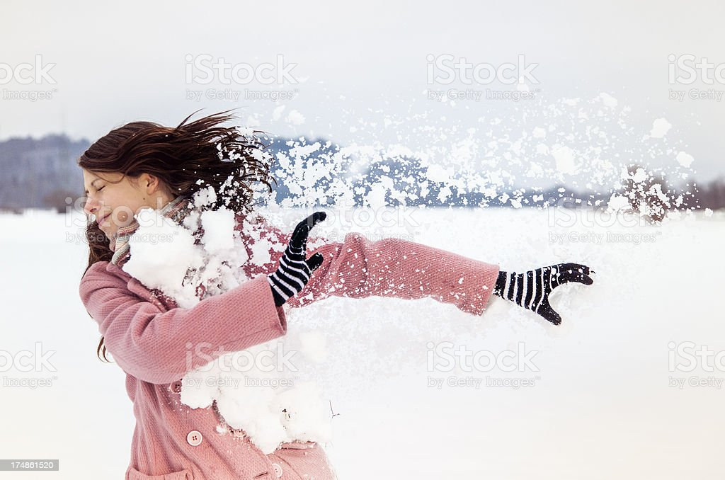 Young female being hit by a snowball royalty-free stock photo
