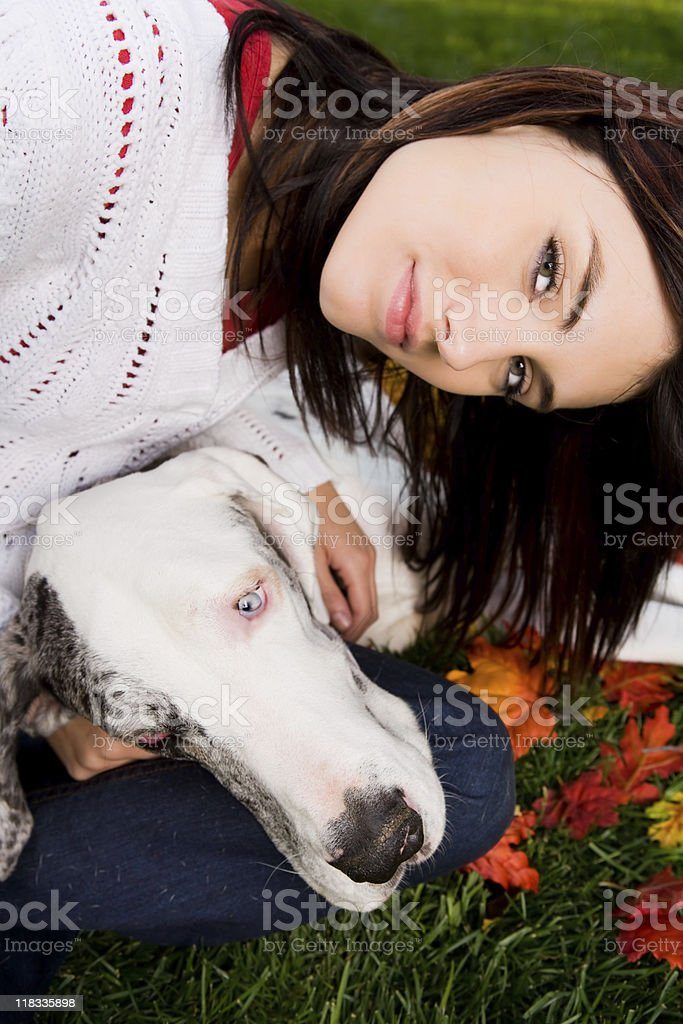 Young female bonding with her dog (great dane) royalty-free stock photo