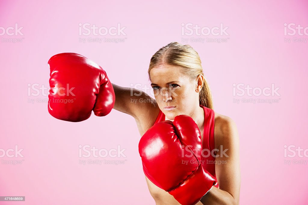 Young female boxer punching royalty-free stock photo