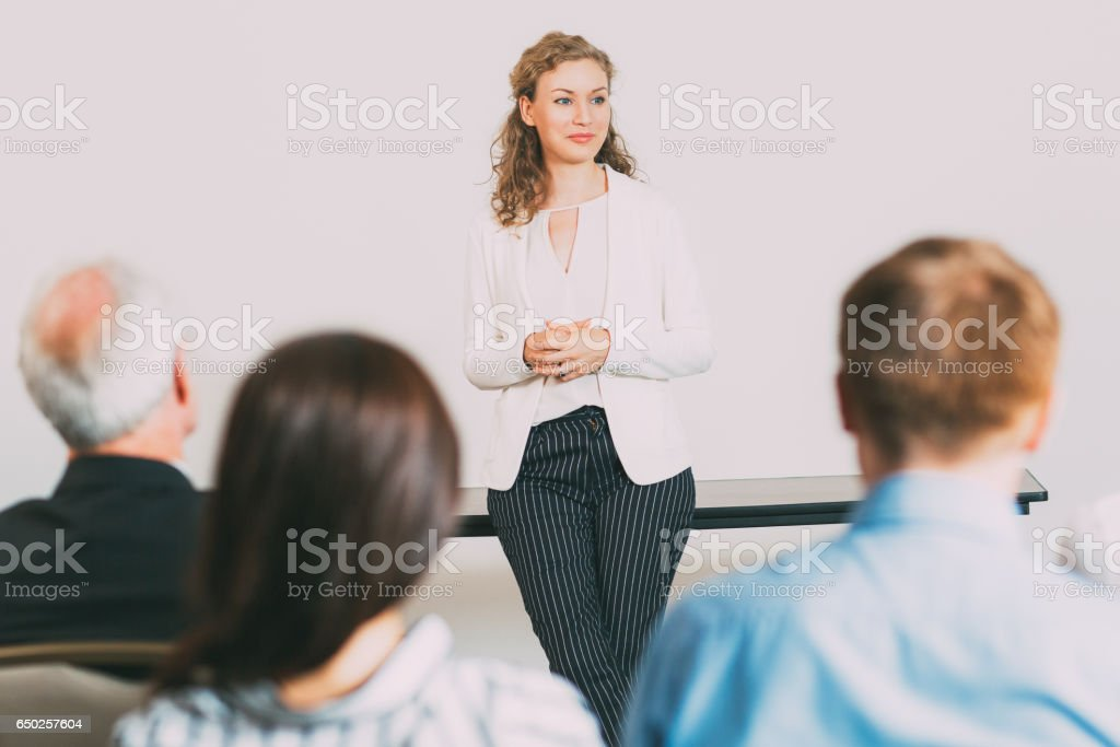 Young Female Businesswoman Holding Report stock photo