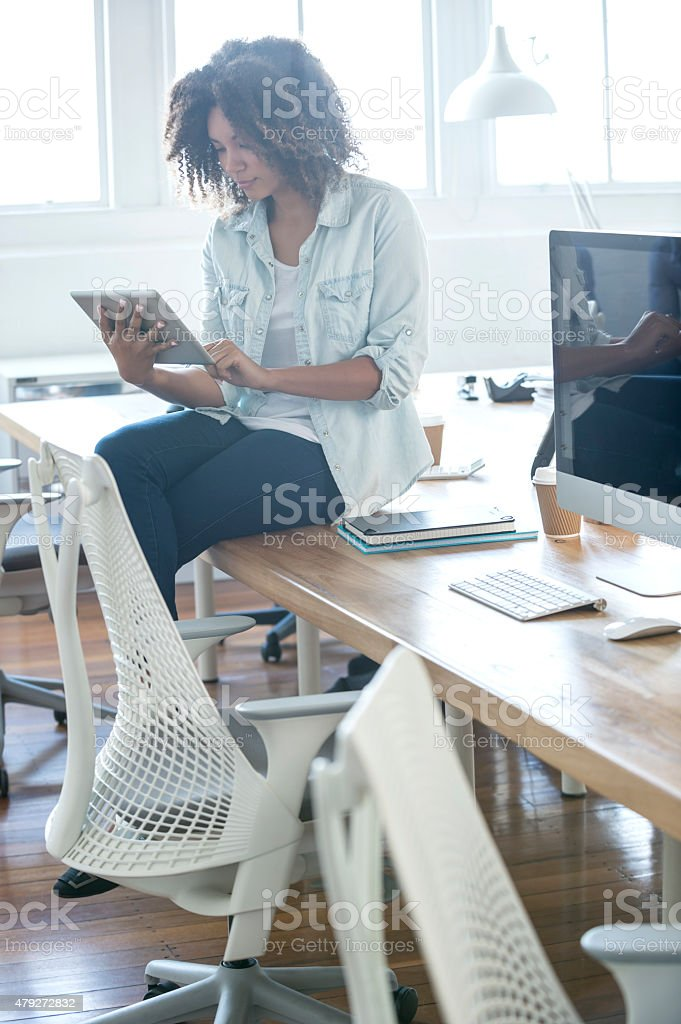 Young female businesswoman looking at her digital tablet stock photo