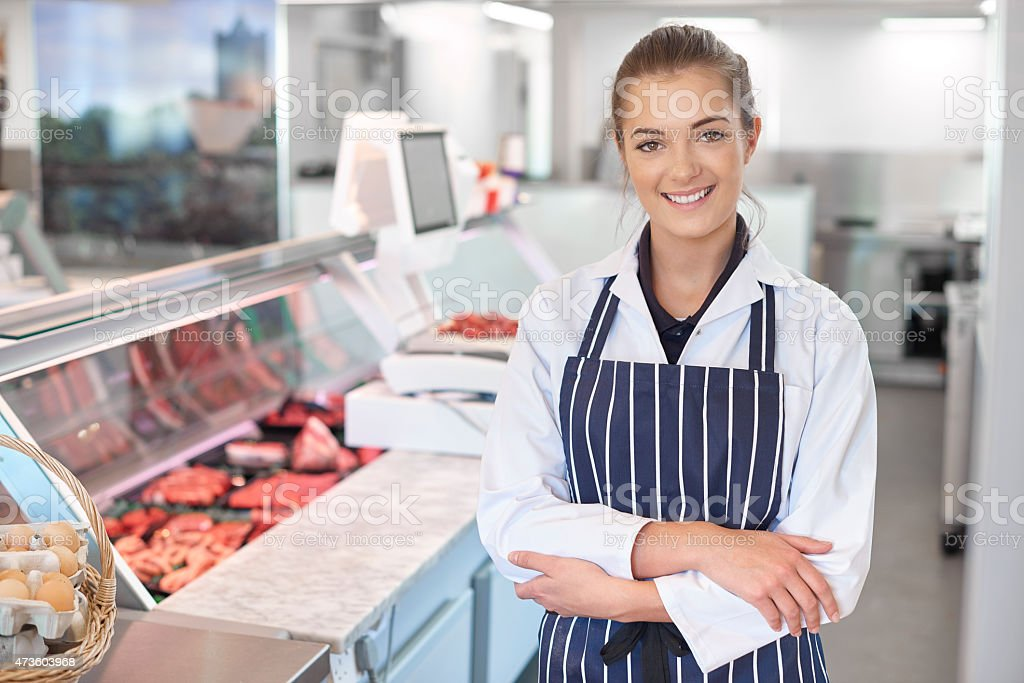 young female butcher portrait stock photo