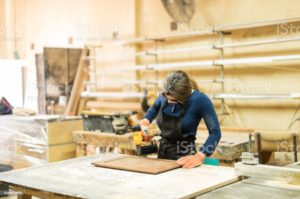 Young female carpenter at work stock photo
