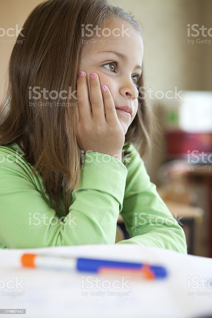 Young female child thinking royalty-free stock photo