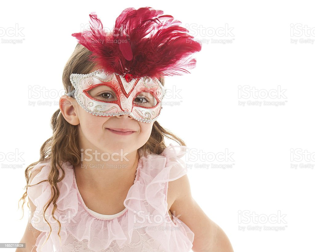 Young female child with red Mardi Gras mask stock photo