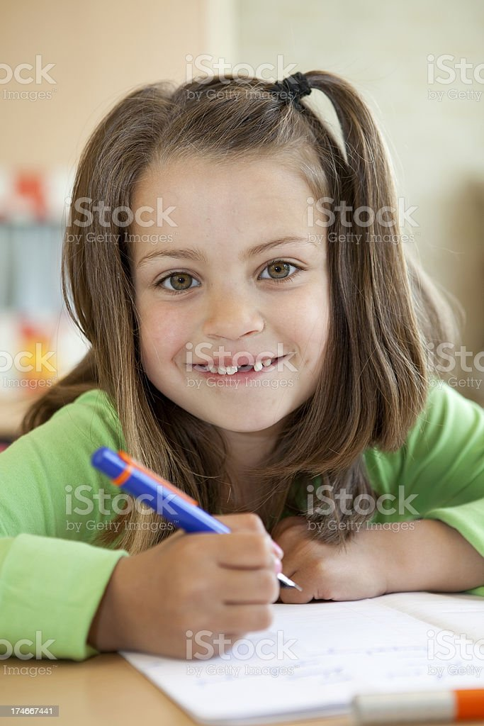 Young female child writing royalty-free stock photo