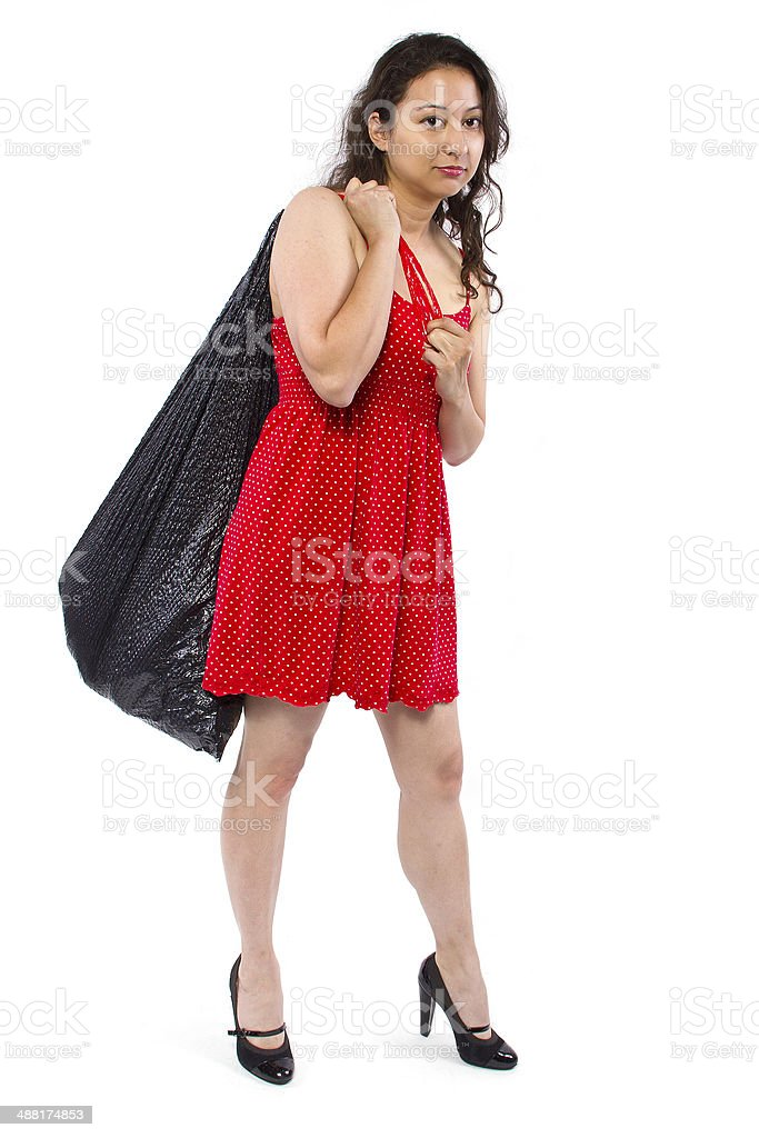 Young Female Cleaning and Carrying Sturdy Trash Bag stock photo