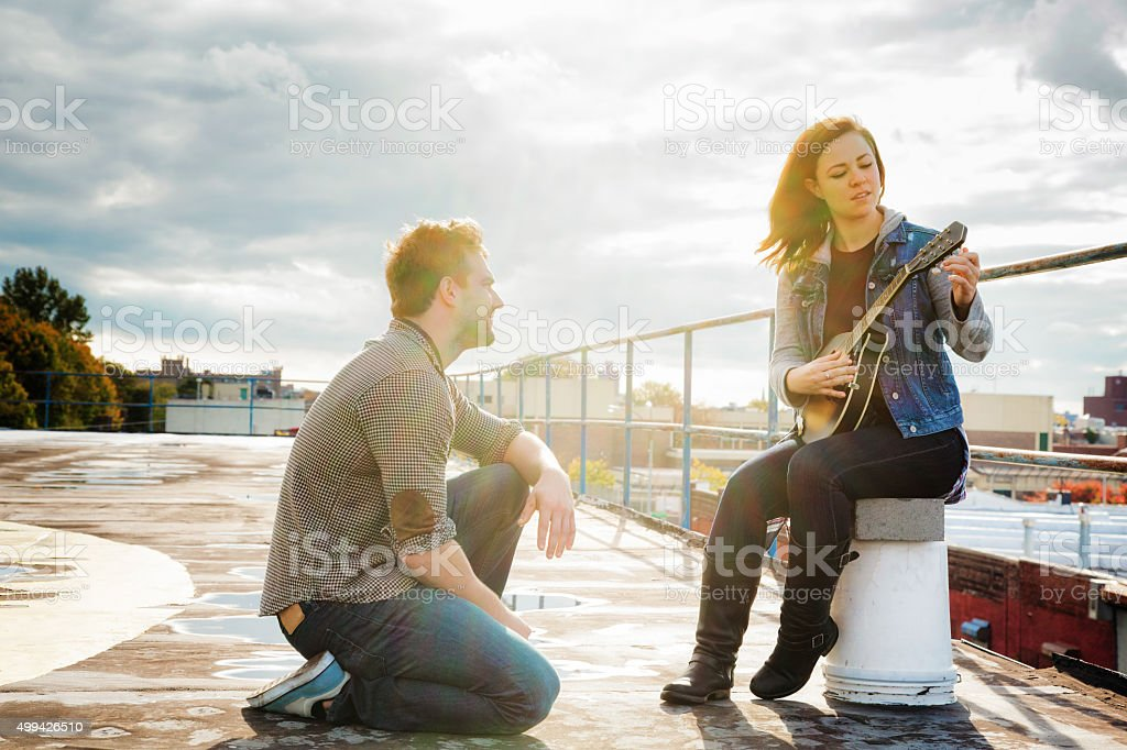 Young Female Country songwriter tunes her mandolin stock photo