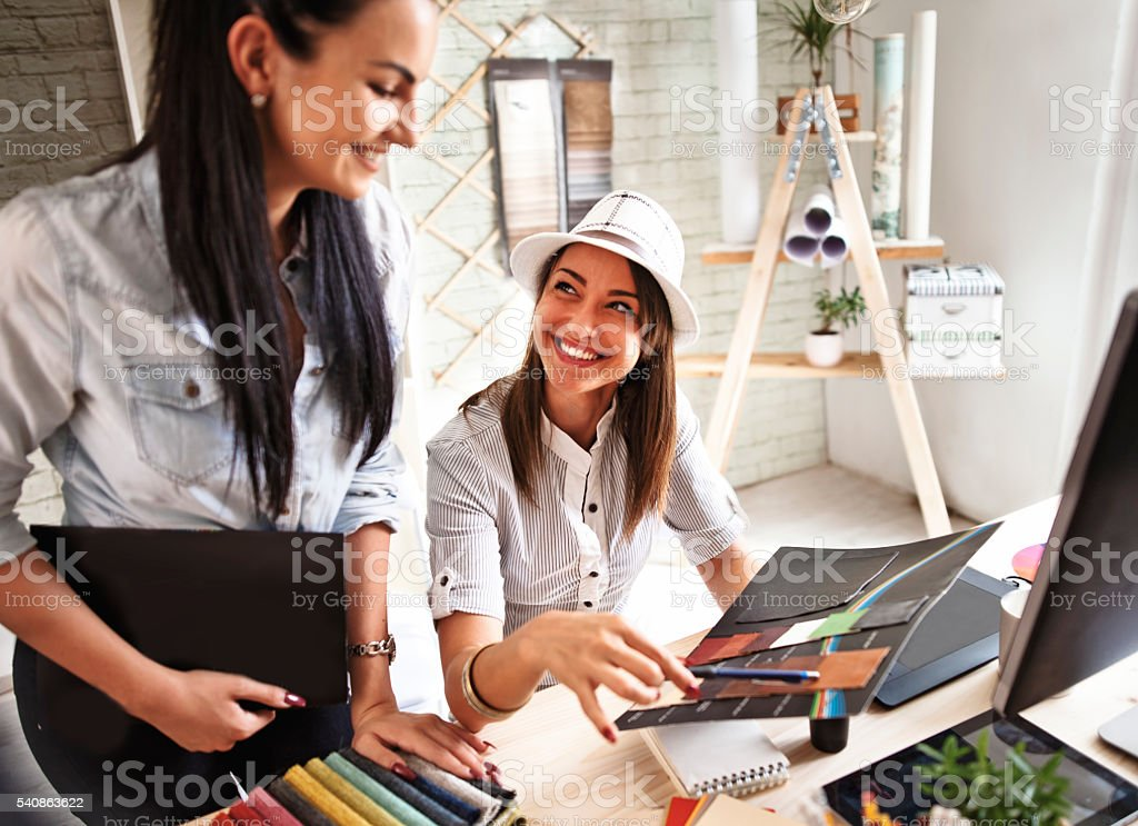 Young female designer in office stock photo