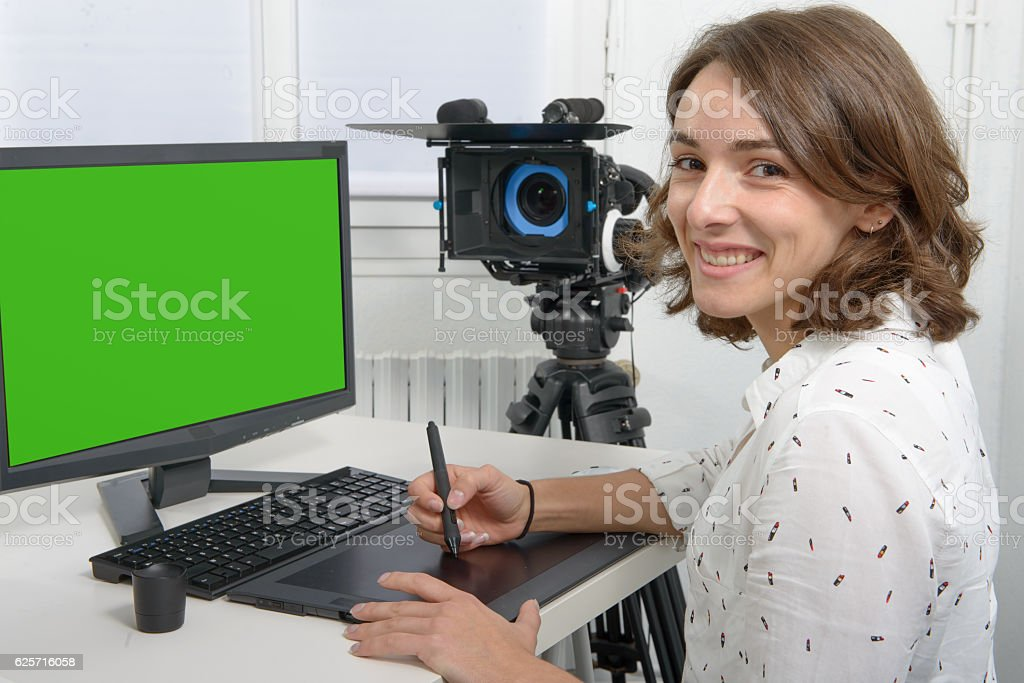 young female designer using graphics tablet stock photo