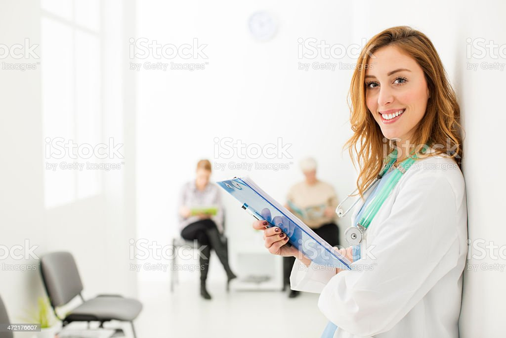 Young Female Doctor At Hospital Corridor. stock photo