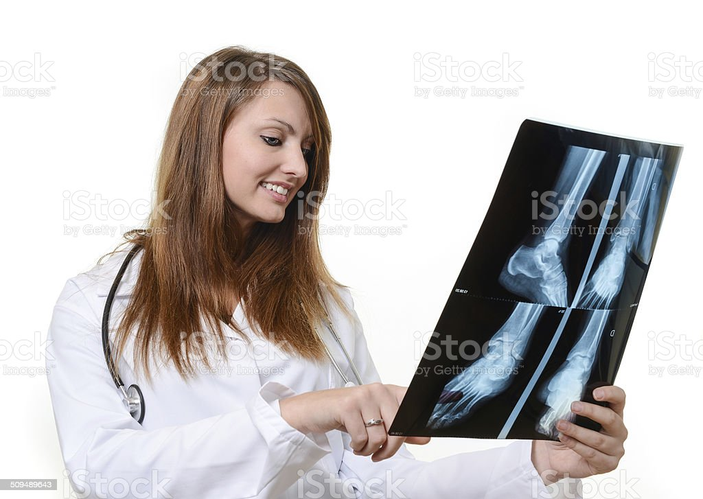 Young female doctor checking an x-ray image royalty-free stock photo