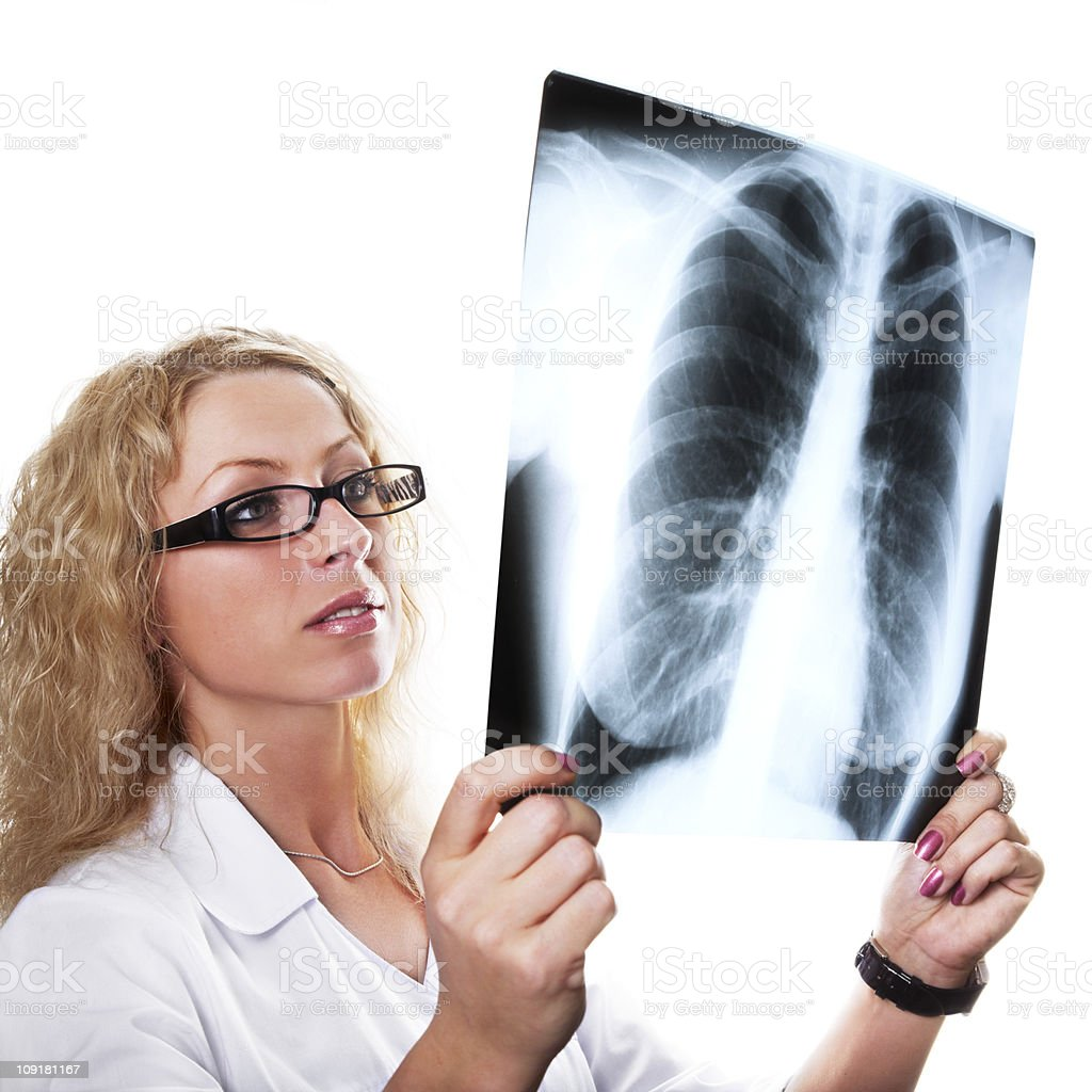 Young female doctor examining xray royalty-free stock photo