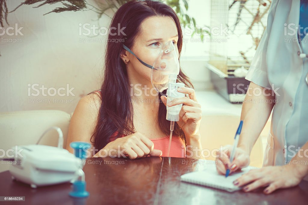 Young female doctor or nurse taking  patients stock photo