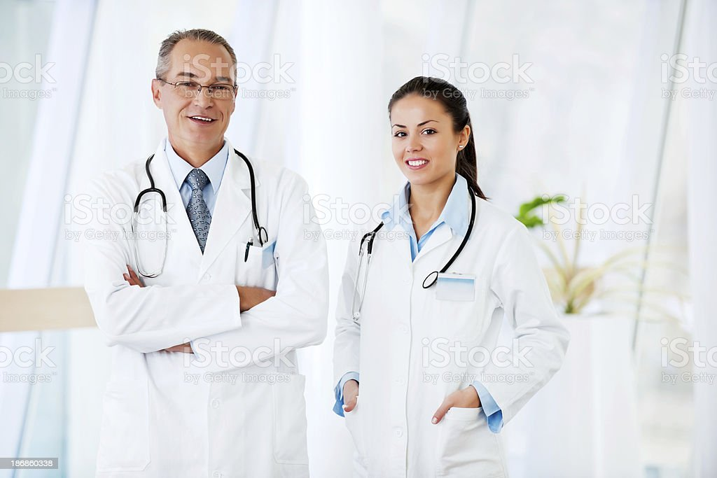 Young female doctor with  senior colleague. royalty-free stock photo