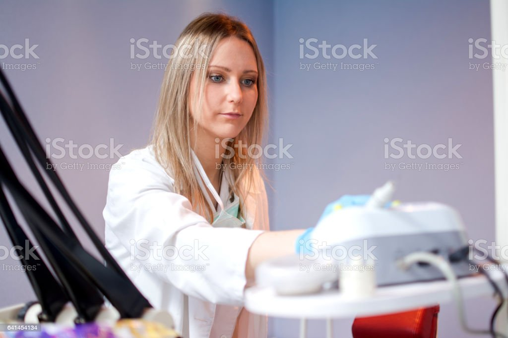 Young female doctor working in laboratory. stock photo